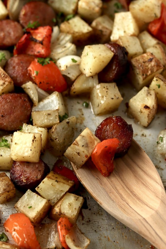 roasted sausage, potatoes, peppers and onions on sheet pan